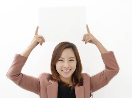 Young Woman Holding a Blank White Sign photo