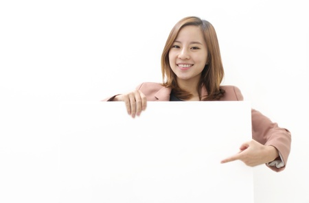 Young Woman Holding a Blank White Sign Stock Photo