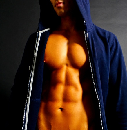 Fit Male in a Hooded Sweater Stock Photo