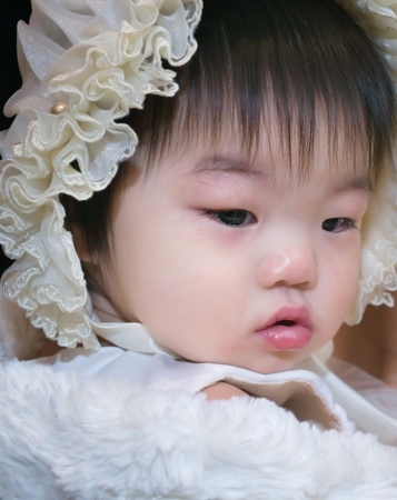 12 15 months: Pouty little girl