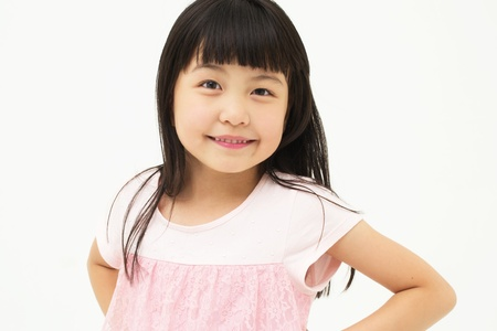 elementary students: Happy little girl on white background