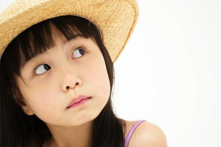 Beautiful asian little girl thinking Stock Photo