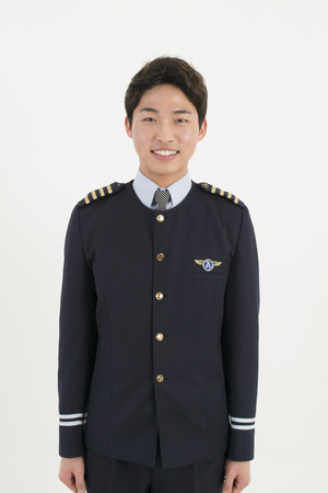 Asian airline pilot isolated on white background