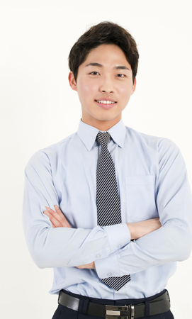 Asian businessman with his arms crossed photo