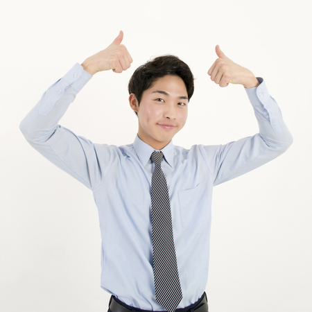 Success businessman thumb up photo