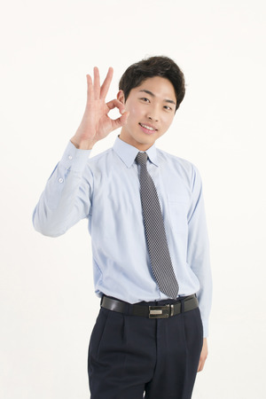 Asian young businessman giving okay sign photo