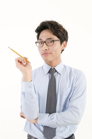 asian teacher: Asian male teacher with a pencil