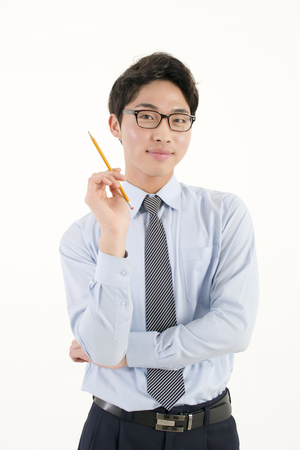 Asian male student with a pencil  photo