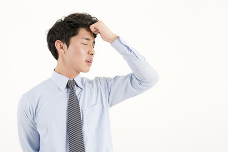 Stressed asian businessman photo