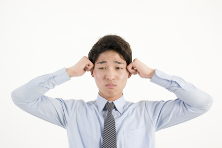 Stressed asian businessman photo