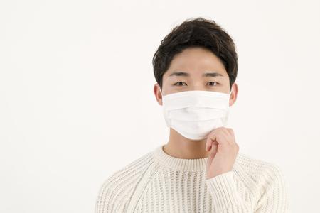 Asian man wearing a face mask