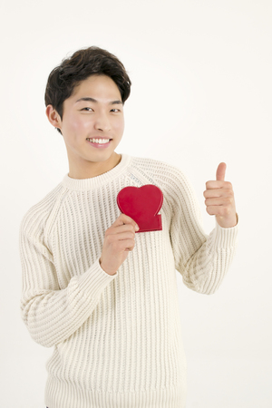 korean man: Smiling man with red heart