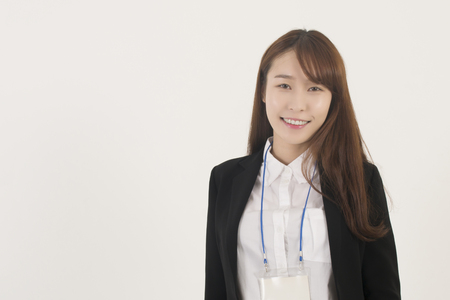 Beautiful young asian businesswoman with id card photo