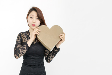 love confession: Pretty asian woman with big heart
