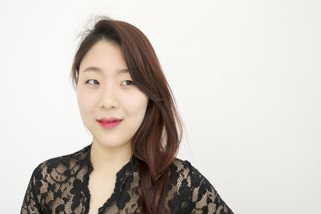 sexy black dress: Beautiful asian woman thinking