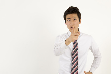 persons: Serious young businessman pointing at you with index finger Stock Photo