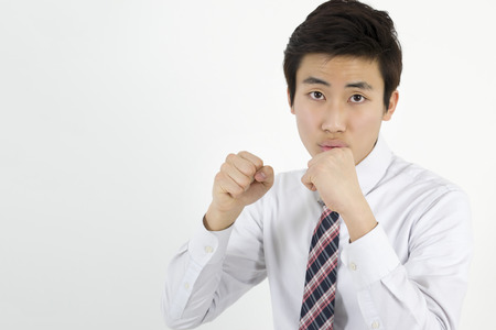 clenching fists: Angry young man clenching his fists