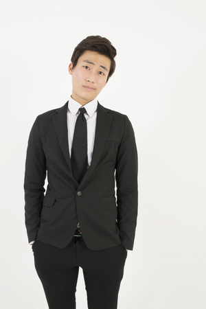 young asian: Asian young man in a black suit Stock Photo