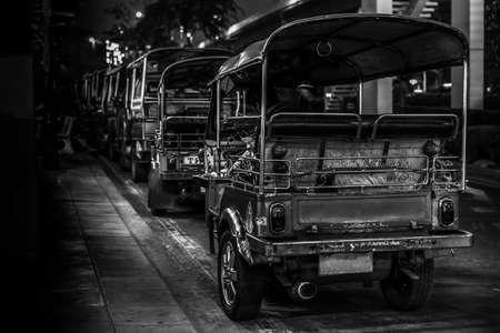 tuk: A  line of Tuk Tuk waiting for the passengers on the street in Bangkok