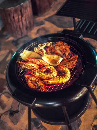 grill: Hot and blazing seafoods on the grill for a family outdoor dinner