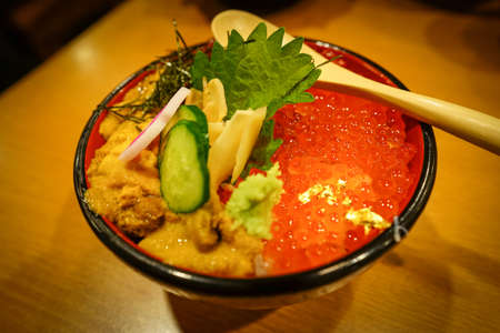 uni: Japanese Food: Sea urchin and salmon roe topped on the rice bowl (Uni and Ikura Don)