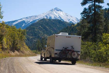 Truck pulls trailer up Kebler Pass road in western Colorado