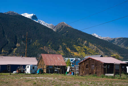 Snowy peak looms above old sheds in Silverton, Colorado