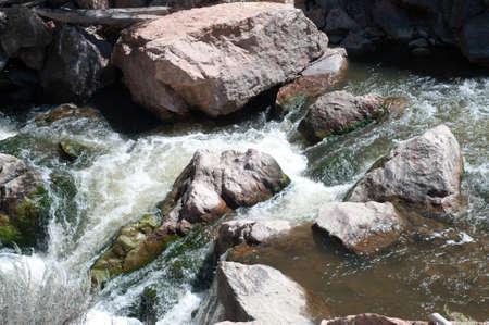Mountain Stream Runs Over Rocks
