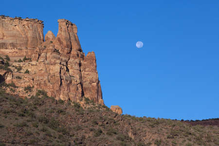 Moon and cliff in the Colorado National Monument
