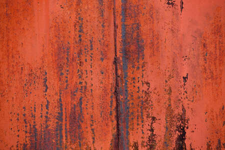 This colorful abstract horizontal photograph shows a rusted section of an old truck.