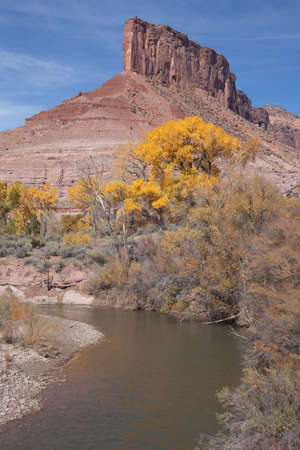 Part of the Dolores River flows past the sandstone butte known as The Palisade at Gateway, Colorado Stock Photo