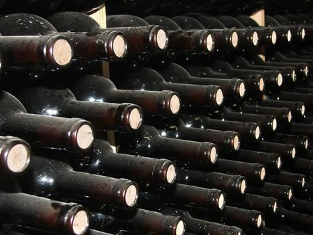 Bottles of wine in rows in wine cellar. Stock Photo - 4864433