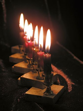 chanukkah: Close up of eight Chanukkah candles.         Stock Photo