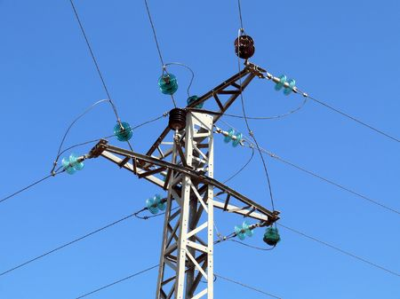 Telegraph pole in intersection of wires on sky background Stock Photo