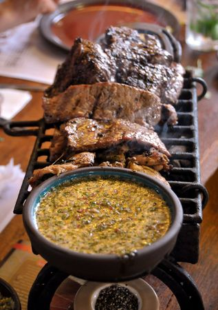 Closeup of grilled meat with seasoning on side.
