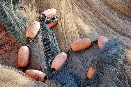 Close up of colored fishing net wirh floats. Stock Photo