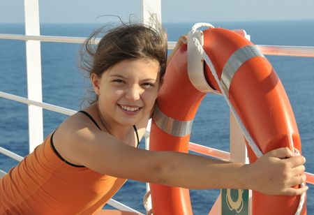 Girl keeping a life-buoy on ship photo