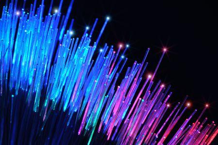 Closeup of colorful optical fibers Фото со стока
