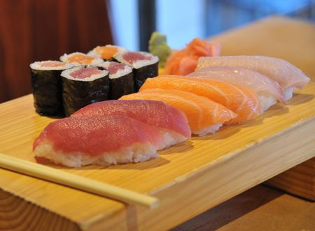 Close-up of sushi meal on wood plate. Stock Photo