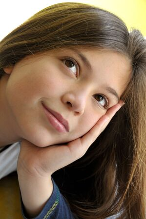 Portrait of cute girl smiling and dreaming  Stock Photo