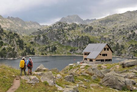 View of Pyrenees hiking trek in mountains and lake in background Stock Photo - 6870095