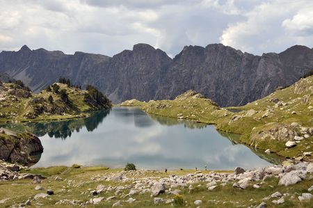 View of a lake surrounded by mountains in Spanish Pyrenees  photo