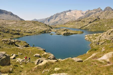 View of lake and mountains in Spanish Pyrenees photo