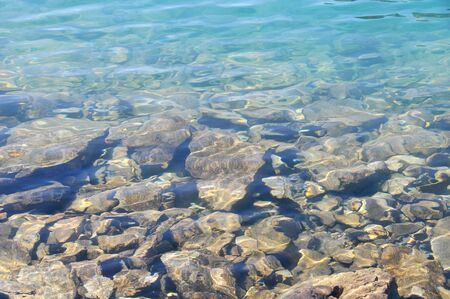 View of rocks on bottom of a lake photo