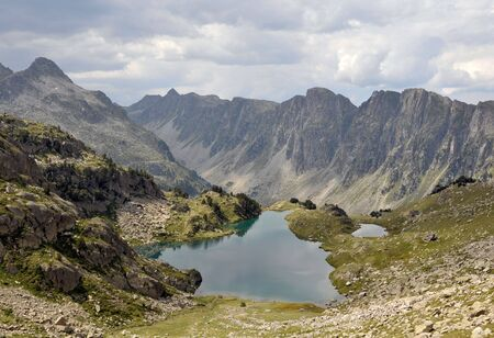 View of beautiful lake in Pyrenees mountains photo