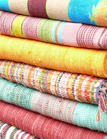 view of colorful carpets lying in stack Stock Photo