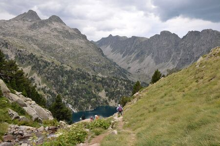 Landscape of Pyrenees mountains with a lake below. photo