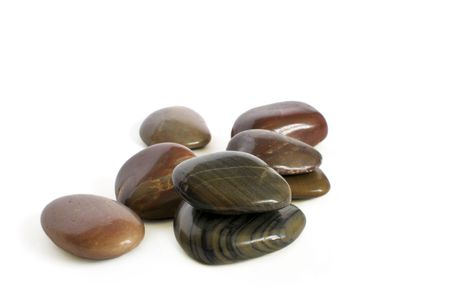 Close-up of few pebbles isolated on white background. Фото со стока