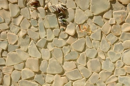 Close-up of wall texture faced with smooth glass pieces.