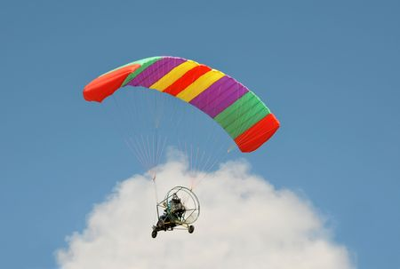 petrol powered: View of powered parachute vehicle on sky background